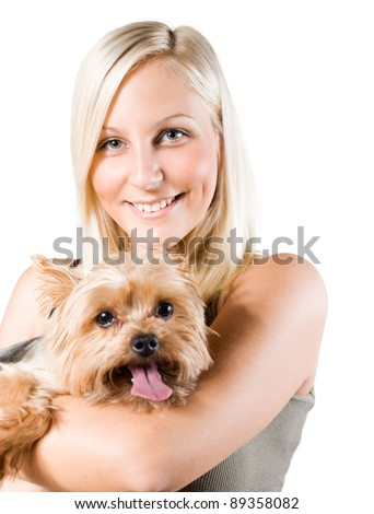 portrait of an attractive young blond woman and her dog.