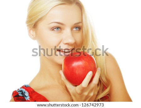 Portrait of an attractive young blond woman with an apple ahainst white background