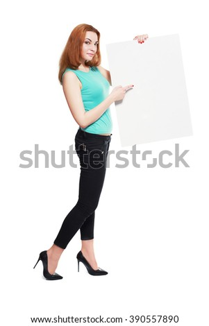 Portrait of an attractive young business woman in glasses holding blank card - over white background - stock photo