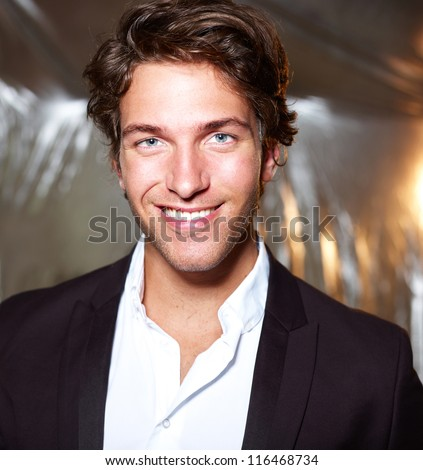 Portrait of an attractive young businessman - smiling - stock photo