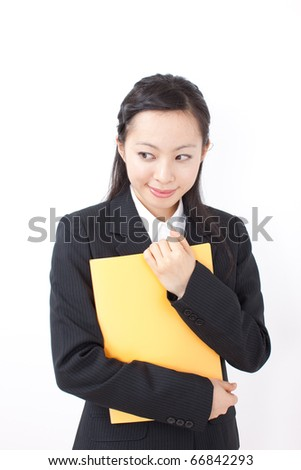 Portrait of an attractive young businesswoman holding yellow file - stock photo