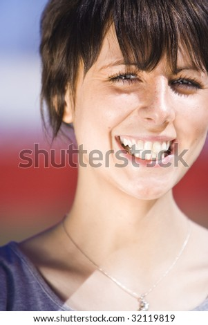 Portrait of an attractive young female - stock photo