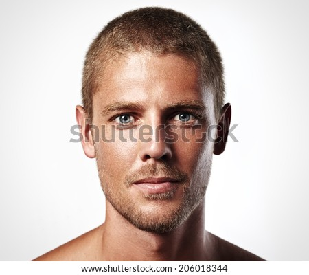 Portrait of an attractive young man isolated on white - stock photo