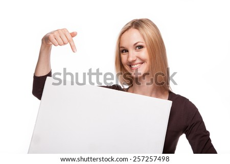 Portrait of an attractive young woman holding blank card - over white background - stock photo