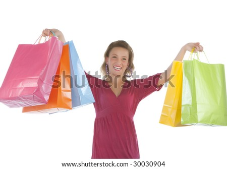 Portrait of an attractive young woman holding several shoppingbags. - stock photo
