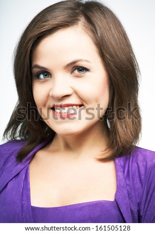 Portrait of an attractive young woman in a lilac dress. On a gray background - stock photo