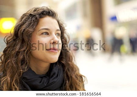 Portrait of an attractive young woman in a warm positive gaze - stock photo
