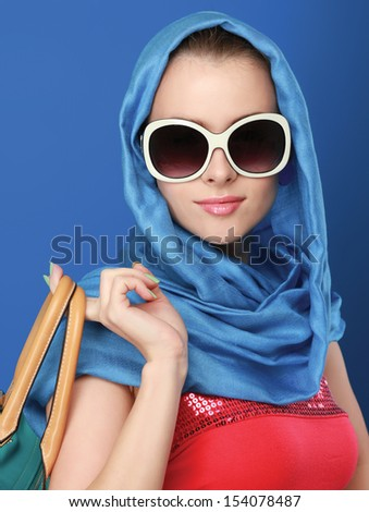 Portrait of an attractive young woman in sunglasses. Retro style.