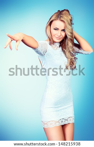 Portrait of an attractive young woman in white dress. - stock photo