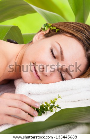 Portrait Of An Attractive Young Woman Lying In A Beauty Spa - stock photo