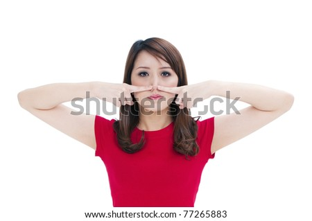 Portrait of an attractive young woman pressing against nose with her fingers, isolated on white background.