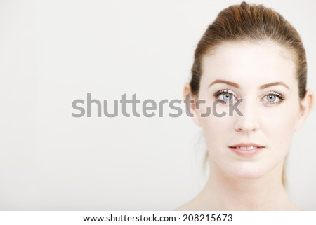 Portrait of an attractive young woman's face looking natural.