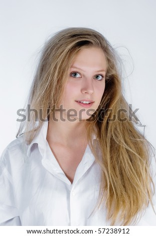 portrait of an attractive young woman with shaggy hair