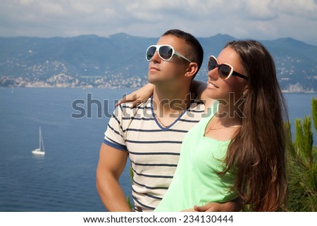 Portrait of an beautiful young couple hugging, enjoying vacation by the sea. Forever together, honeymooners in France Riviera.