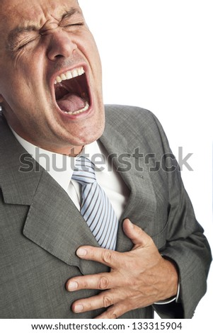 portrait of an businessman getting a heart attack - stock photo