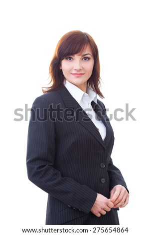 Portrait of an confident businesswoman in formal suit standing against isolated background.  - stock photo