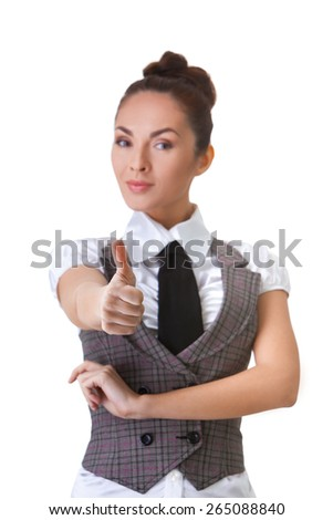 Portrait of an confident businesswoman. Thumbs Up. This photo has been produced with these professionals : make-up artist, hair dresser and stylist.  - stock photo