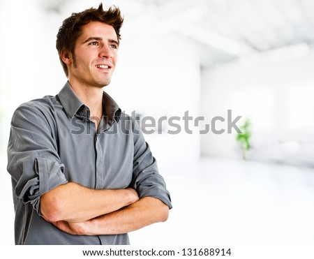 Portrait of an confident young man - stock photo