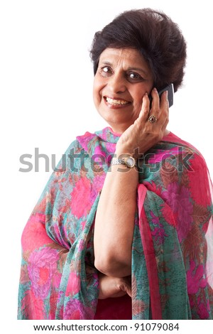 Portrait of an East Indian woman talking on her mobile phone