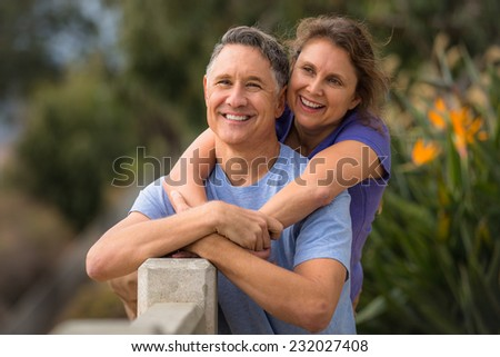 Portrait of an elder couple in a park - stock photo