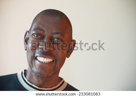 Portrait of an elderly African cheerful men
