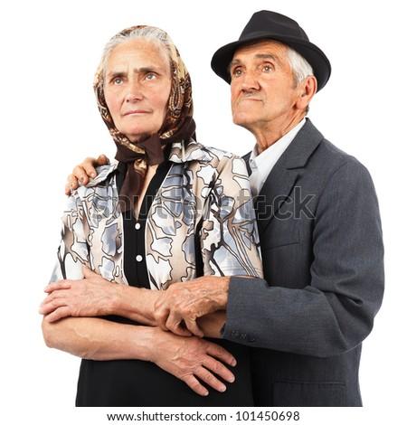 Portrait of an elderly couple in studio - stock photo