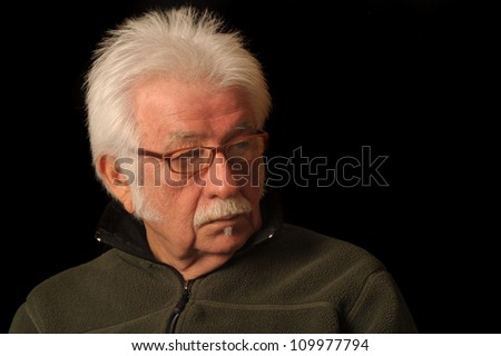 Portrait of an elderly man looking to the side - stock photo