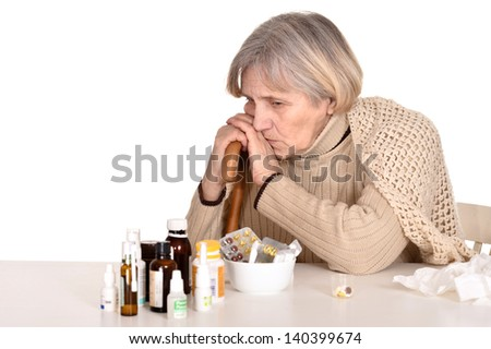 portrait of an elderly sick woman over a white background