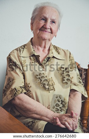 Portrait of an elderly smiling woman - stock photo