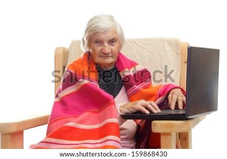 Portrait of an elderly using a notebook - stock photo