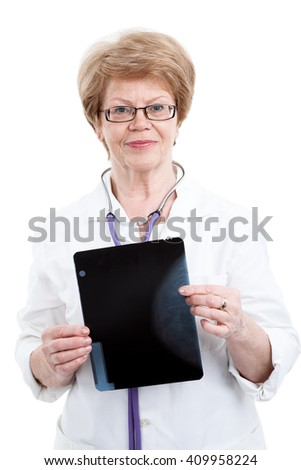 Portrait of an elderly woman doctor holding a x-ray image, isolated on white background - stock photo