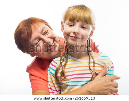 portrait of an elderly woman hugging a little girl