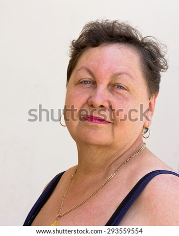 Portrait of an elderly woman in summer clothes.Closeup.