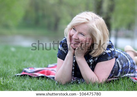 portrait of an elderly woman in the Spring Park - stock photo