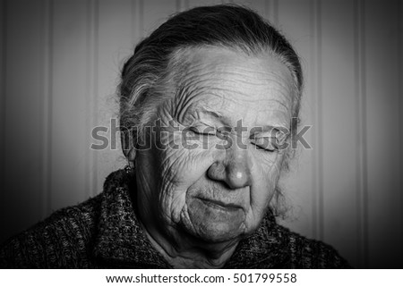 Portrait of an elderly woman on a light background. Toned.