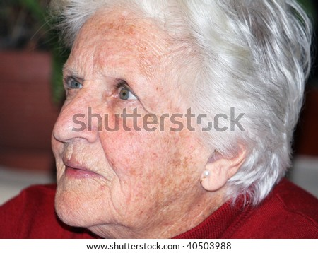 portrait of an elderly woman showing crucial signs of ageing - stock photo