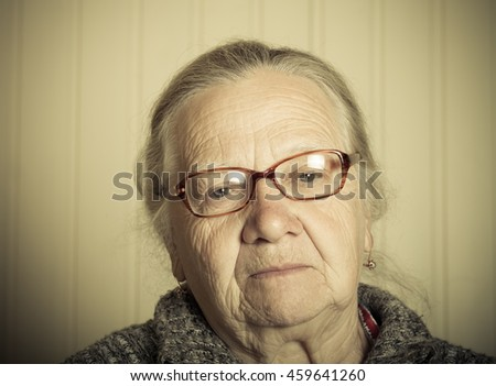 Portrait of an elderly woman. Toned.