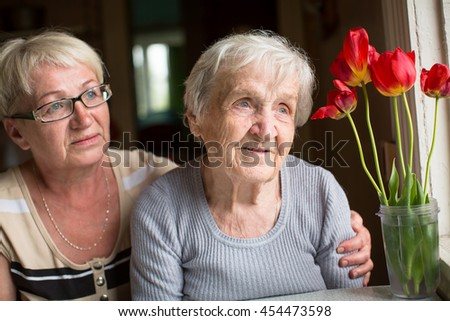 Portrait of an elderly woman with adult daughter. - stock photo