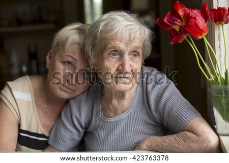 Portrait of an elderly woman with her daughter. - stock photo