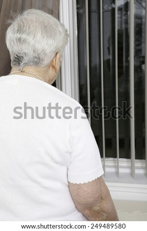 portrait of an elderly woman with problem - stock photo