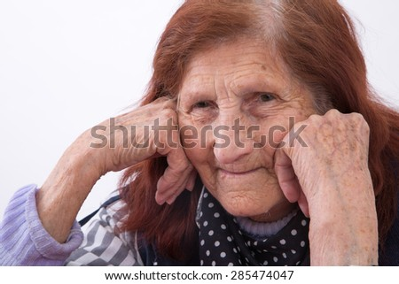 Portrait of an elderly woman with satisfied face expression.