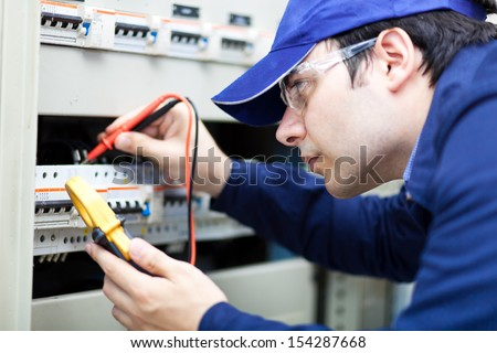 Portrait of an electrician at work  - stock photo
