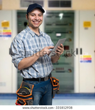 Portrait of an electrician using his tablet computer - stock photo