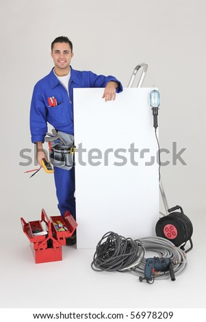 Portrait of an electrician with a white panel on white background