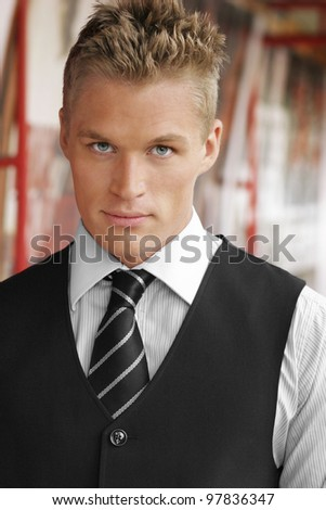 Portrait of an elegant good looking young businessman outdoors