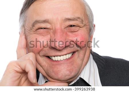 Portrait of an elegant senior man isolated on white background - stock photo