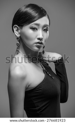 Portrait of an elegant young  asian woman in black evening dress. Black and white fashion shot.