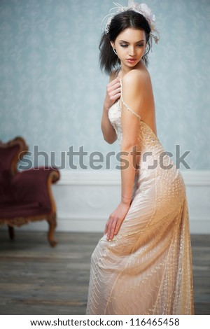 Portrait of an elegant young bride wearing vintage dress - stock photo