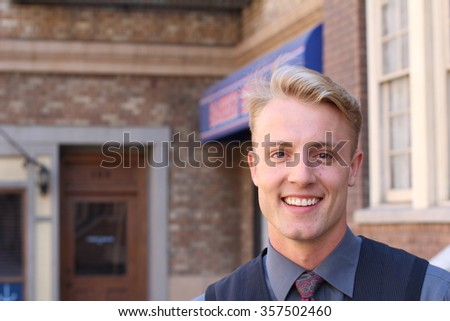 Portrait of an elegant young man outside with copy space on the right side of the image. - stock photo