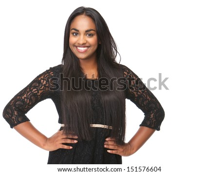 Portrait of an elegant young woman smiling on isolated white background - stock photo